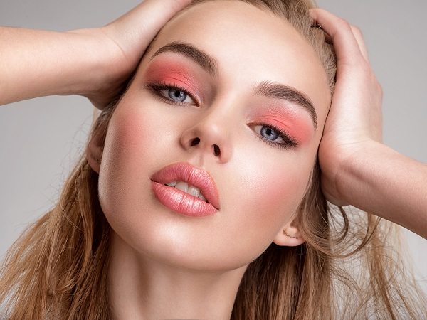 Portrait of a beautiful Russian woman with a coral color makeup